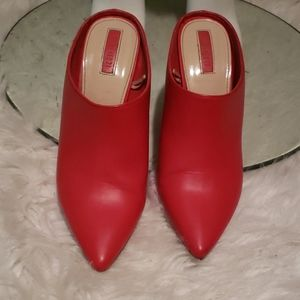 Red pointy toe slide ins